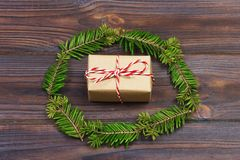 Black wooden christmas background. twigs of thuja. Original, fresh floral design for xmas card. empty space for holiday greetings Royalty Free Stock Photo