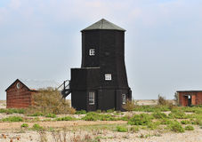 Black wooden coastal tower Stock Images