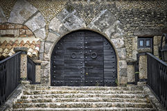 Black wooden door of a castle Stock Images