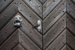 Black wooden door with iron decoration background and texture Stock Photos