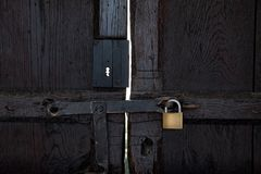 Black wooden door with a padlock Royalty Free Stock Image
