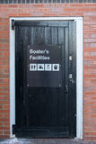 A black, wooden door, with a sign saying `Boaters Facilities` Stock Image