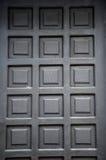 Black wooden doors. New black wooden doors at a building Stock Photo