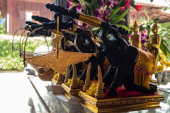 Black wooden elephants carry net basket Royalty Free Stock Images