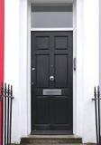 Black wooden entrance door Stock Photo