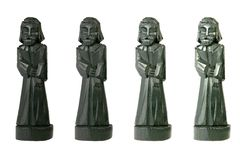 Black wooden figures with different shades Stock Photo