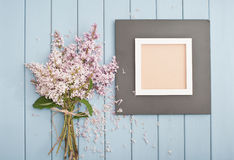 Black wooden frame and flowers Stock Photos