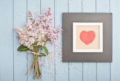 Black wooden frame with red heart and flowers Royalty Free Stock Images