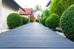 Black wooden garden path. In tropical garden Royalty Free Stock Photos