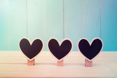 Black wooden heart shaped clothespins Stock Images