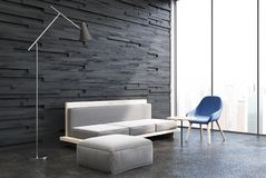 Black wooden living room, white sofa. Black wooden living room interior with a white sofa, a pouffe and a blue chair standing next to a panoramic window. 3d Royalty Free Stock Photography