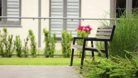 Black wooden and metal bench stock footage