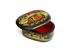 Black wooden painted Russian casket. Oval lacquered black Russian casket painted with troika horses isolated Royalty Free Stock Photo