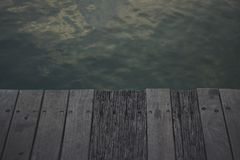 Black Wooden Panel Beside Body of Water Stock Photos