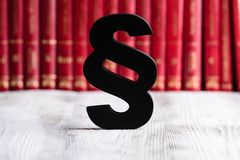 Black wooden paragraph the symbol of law Royalty Free Stock Photos