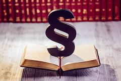 Black wooden paragraph. The symbol of law in court library with legal codes. Law concept Royalty Free Stock Image