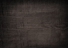 Black wooden plank, tabletop, floor surface or chopping, cutting board. Royalty Free Stock Photography