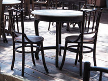 Black wooden round dining tables with chairs. At outdoor restaurant Royalty Free Stock Photography