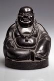 Black wooden statue  Buddha Royalty Free Stock Photography
