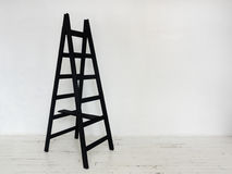 Black wooden stepladder in interior Royalty Free Stock Photos