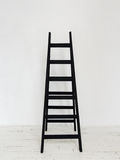 Black wooden stepladder in interior Royalty Free Stock Photo