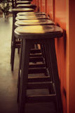 Black Wooden Stools in a Red Cafe Stock Photography