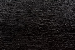 Black wooden surface background. Royalty Free Stock Photos
