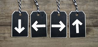 Black wooden tags with arrows royalty free stock image