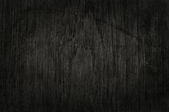 Black wooden wall background, texture of dark bark wood. royalty free stock photography