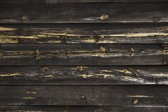 Black wooden wall stock image