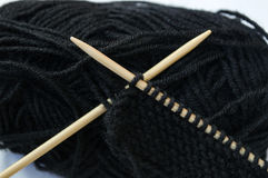 Black wool with bamboo knitting needles Royalty Free Stock Photography