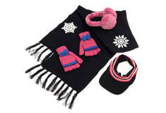 Black wool scarf with matching pink gloves,a visor hat and earmuffs. Pink and black winter accessories isolated on white background Stock Photos