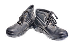Black working man's boots isolated on a white Stock Image