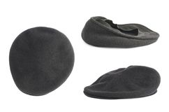 Black woven beret flat-crowned hat isolated Royalty Free Stock Images