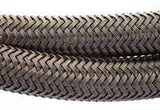 Black woven braided tube housing cable Stock Photos