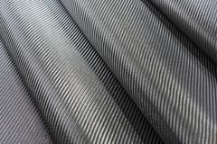 Black woven carbon fiber or Kevlar texture for background. Royalty Free Stock Image