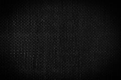 Black woven plastic cloth texture Stock Photography