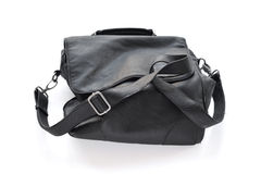 Black wrinkled leather bag with shoulder strap. Stock Photography