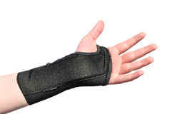 Black Wrist Brace. Arm Wrapped in a Black Wrist Brace Isolated on White Royalty Free Stock Photography
