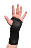 Black Wrist Brace. Arm Wrapped in a Black Wrist Brace  on White Royalty Free Stock Images