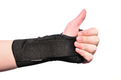 Black Wrist Brace. Arm Wrapped in a Black Wrist Brace Doing Thumbs Up Isolated on White Royalty Free Stock Photography