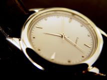 Black Wrist Watch, Gold Face Royalty Free Stock Photos
