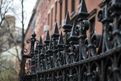 Black wrought iron fence Stock Photo
