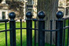 Black wrought iron fence posts, closeup stock images
