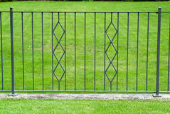 Black wrought iron gate Stock Images