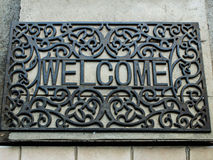 Black wrought iron welcome rug Royalty Free Stock Images
