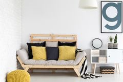 Black and yellow accessories. Black and yellow home accessories in white interior stock photography