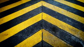 Black and yellow caution warning  patten background on the floor Stock Image