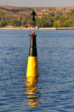 Black and yellow channel marker Stock Photos