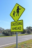 Black and yellow children crossing ahead sign Royalty Free Stock Photography